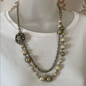 Costume silver broach and pearls necklace